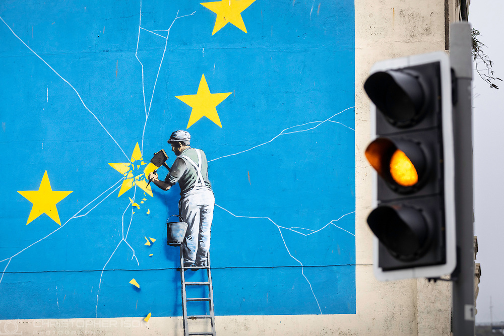 What next for Brexit??<br /> An amber traffic light beside Banksy's famous Brexit mural on the side of a derelict building in Dover. <br /> Prime Minister Theresa May is meeting European leaders today to ask for an extension in the hope of avoiding a no-deal Brexit. <br /> Picture date Wednesday 10th April, 2019.<br /> Picture by Christopher Ison. Contact +447544 044177 chris@christopherison.com