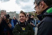 Actress Jamie Winstone speaks with journalist George Monbiot on Trafalgar Square  on 16th October 2019 in England, United Kingdom. This is despite the police imposing a section 14 of the Public Order Act 1986, in effect banning all protest by the group in London. The group demand that the government take urgent action to tackle climate change.