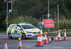 """© Licensed to London News Pictures. 25/08/2021. Guildford, UK. Police guard a crime scene on the north bound slip road to the A3 in Guildford, Surrey. A murder investigation has been launched after a woman's body was discovered on Monday 23rd August after a member of the public made the discovery in some undergrowth. An investigation, led by Surrey and Sussex's Major Crime Team is in the early stages. Enquiries remain ongoing to identify the woman, believed to be in her forties. Two men have been arrested in connection with the investigation. They remain in custody. Senior Investigating Officer Detective Chief Inspector Emma Vickers said: """"We are investigating this as a murder which we believe has been committed elsewhere with the victim's body left in this location. Photo credit: Peter Macdiarmid/LNP"""