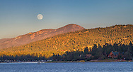 USA, California, Big Bear. Moonrise and sunset over Big Bear Lake in Southern California.