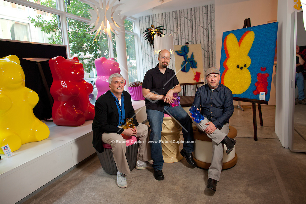 New York - May 13, 2012 - (L-R) Mario Marsicano, Kevin Champeny, and Chris Lenox of Jellio, a company that manufacturers very unusual and very whimsical home furnishings in Long Island City photographed at a pop sale in SoHo... Photo by Robert Caplin