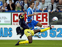 Photo: Olly Greenwood.<br />Colchester United v Derby County. Coca Cola Championship. 26/08/2006. Colchester Uniteds Karl Duguid and Derbys Mo Camara