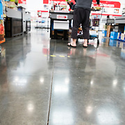 Costco put tape on the floor to mark the proper distance for social distancing. Limited number of people are permitted in the store as well to avoid crowds.