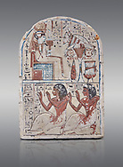 """Ancient Egyptian Ra stele , limestone, New Kingdom, 19th Dynasty, (1279-1190 BC), Deir el-Medina,  Egyptian Museum, Turin. Grey background.<br /> <br /> Khonsu sits on a cube-like throne and wears the solar disc and half-moon on his head. He faces an offering table piled with food and flowers. The hieroglyphic inscription reads: """"Khonsu-in-Thebes, Neferhotep. Protection, life, stability and power surround him, like Ra. Libation for your ka with bread, beer, oxen and fowl.""""Lower register depicts two men kneeling in adoration. They face to the left: Nebre, whose title is kedw sesh """"draughtsman"""" and his son, Amenemope.""""Give praise to Khonsu-in-Thebes by the scribe of Amun in the Place of Truth Nebra, justified in peace, he loved his son, Amenemope, justified"""".In the bottom register are the """"Draughtsman-scribe of Amun in the Place of Truth"""", Nebre, and his son, Amenemope""""<br /> <br /> Akh iqer en Ra """" the excellent spirit of Ra' stele.One of three stele forund in different rooms of houses in Deir el-Medina where they stood in niches .<br /> <br /> If you prefer to buy from our ALAMY PHOTO LIBRARY  Collection visit : https://www.alamy.com/portfolio/paul-williams-funkystock/ancient-egyptian-art-artefacts.html  . Type -   Turin   - into the LOWER SEARCH WITHIN GALLERY box. Refine search by adding background colour, subject etc<br /> <br /> Visit our ANCIENT WORLD PHOTO COLLECTIONS for more photos to download or buy as wall art prints https://funkystock.photoshelter.com/gallery-collection/Ancient-World-Art-Antiquities-Historic-Sites-Pictures-Images-of/C00006u26yqSkDOM"""