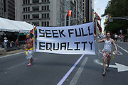 """A banner reading """"Seek full equality"""" is borne by Marriage Equality USA."""