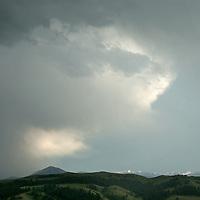 Montana's Spanish Peaks rise behind the Story Hills, near Bozeman.