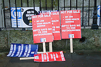Placards left behind after protest march in Dublin Ireland as part of a campaign organised by the Irish Congress of Trade Unions