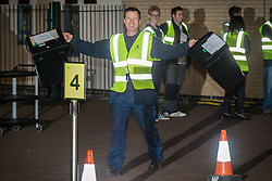 © Licensed to London News Pictures . 07/05/2015 . Doncaster , UK . A man runs in with the very first ballot boxes to arrive back at the count . The count for the 2015 General Election in Labour Party leader Ed Miliband's constituency of Doncaster North , at Doncaster Racecourse . Photo credit : Joel Goodman/LNP