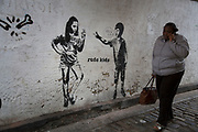 Street art work entitled Rude Kids on Bermondsey Street in Southwark, London, UK. This street is a very gentrified and trendy stylish area, and now home to a sort of ironic graffiti.