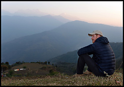 Image ©Licensed to i-Images Picture Agency. 22/03/2016. Kathmandu, Nepal. Prince Harry Nepal Tour - Day Four. Prince Harry watches the Sunrise at Leorani hamlet at the foothills of the Himalayas. Picture by Andrew Parsons / i-Images