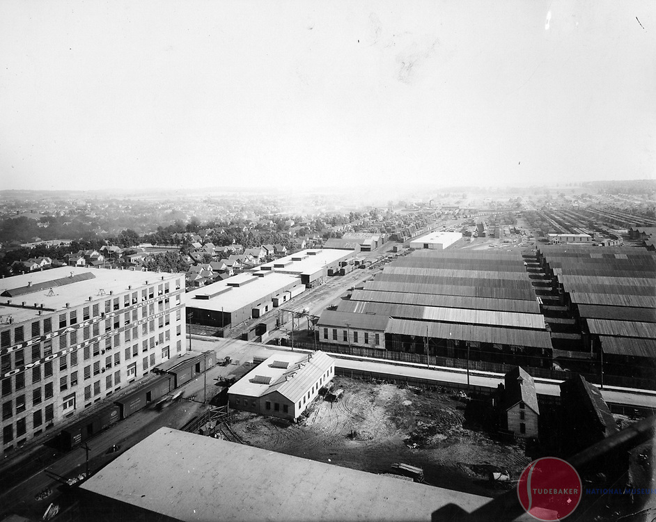 Studebaker's South Bend plant's lumberyards located south of Sample Street.  Image taken from powerplant smokestack 1911. Studebaker buildings 53 and 58 are visible on the right.  They later housed the Newman and Altman Studebaker parts business.