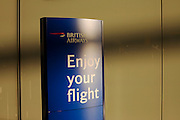 A British Airways check-in wishes its passengers an enjoyable flight, seem in departures of at Heathrow Airport's Terminal 5.