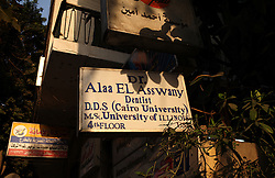 A sign hangs outside the home and office of Dr. Ala'a Al-Aswany, a prominent Egyptian writer and founding member of the political movement Kefaya in Cairo, Egypt on April 4, 2008. Trained as a dentist in Cairo and Chicago, Al-Aswany has contributed numerous articles to Egyptian newspapers on literature, politics, and social issues. His second novel, The Yacoubian Building, an ironic depiction of modern Egyptian society, has been widely read in Egypt and throughout the Middle East. It was translated into English and was adapted into a film (2006) and a television series (2007) of the same name. Chicago, Al-Aswany's latest novel, is set in the American city where he had attended college.