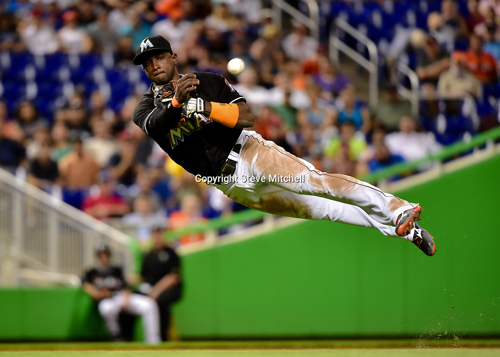 Jul 28, 2016; Miami, FL, USA; Miami Marlins shortstop Adeiny Hechavarria (3) throws out St. Louis Cardinals right fielder Stephen Piscotty (not pictured) during the ninth inning at Marlins Park. The Cardinals won 5-4. Mandatory Credit: Steve Mitchell