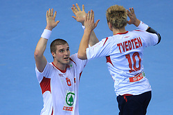Bjarte Myrhol of Norway and Havard Tvedten of Norway celebrate during 21st Men's World Handball Championship preliminary Group D match between Norway and Egypt, on January 19, 2009, in Arena Zatika, Porec, Croatia. Win of Norway 30:20.(Photo by Vid Ponikvar / Sportida)