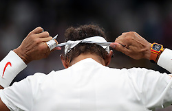 Rafael Nadal adjusts his Nike headband during his match against Novak Djokovic on day eleven of the Wimbledon Championships at the All England Lawn Tennis and Croquet Club, Wimbledon. PRESS ASSOCIATION Photo. Picture date: Saturday July 14, 2018. See PA story TENNIS Wimbledon. Photo credit should read: Daniel Leal-Olivas/PA Wire. RESTRICTIONS: Editorial use only. No commercial use without prior written consent of the AELTC. Still image use only - no moving images to emulate broadcast. No superimposing or removal of sponsor/ad logos. Call +44 (0)1158 447447 for further information.