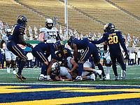 Dec 5, 2020; Berkeley, California, USA; Oregon Ducks quarterback Tyler Shough (12) short of the goal line against the California Golden Bears during the first quarter at California Memorial Stadium. Mandatory Credit: Kelley L Cox-USA TODAY Sports