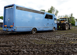 © Licensed to London News Pictures. 11/05/2012. Windsor, UK A horse box is towed through mud by a tractor. The Royal Windsor Horse Show in Windsor, England on May 11 2012. Photo credit : Stephen Simpson/LNP
