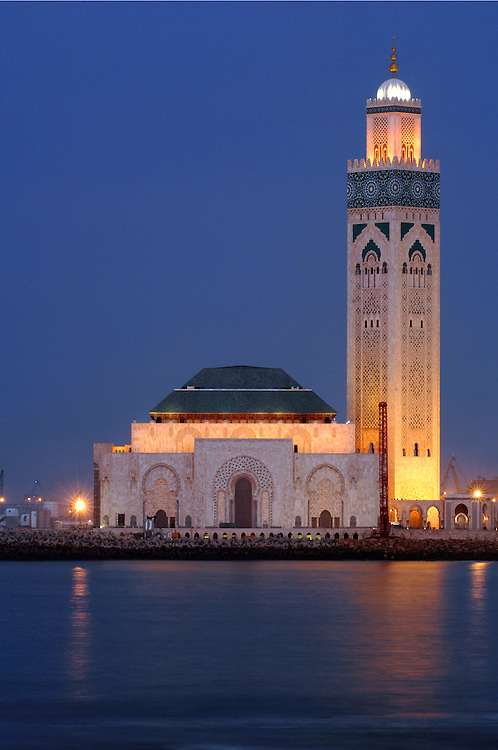 """Casablanca, Morocco 15 October 2006<br /> Hassan II Mosque. <br /> This mosque was designed by the French architect Michel Pinseau and is the second largest in the world (after the Masjid al-Haram in Mecca).  <br /> Its minaret is also the world's tallest at 210m. Built on reclaimed land, almost half of the surface of the mosque lies over the Atlantic water. This was inspired by the verse of the Qur'an that states """"the throne of God was built on the water"""".<br /> Photo: Ezequiel Scagnetti"""