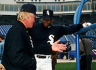 CHICAGO - 1993:  Frank Thomas of the Chicago White Sox talks with White Sox hitting coach Walt Hriniak during batting practice prior to an MLB game at Comiskey Park in Chicago, Illinois.  Thomas played for the White Sox from 1990-2005. (Photo by Ron Vesely)