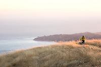 Young man biking near Bolinas Ridge; Mt. Tamalpais State Park. Golden Gate National Recreation Area. San Francisco,  CA.