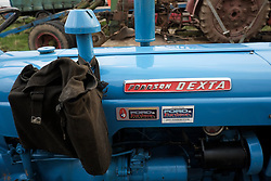 © Licensed to London News Pictures. <br /> 30/11/2014. <br /> <br /> Boulby, United Kingdom<br /> <br /> A haversack hangs from the exhaust of a Ford Dexta tractor at the start of the ploughing match that takes place each year on fields next to the picturesque Yorkshire coastline near Staithes. Farmers attend each year to demonstrate their ploughing skills and to help raise money for charity with proceeds from this year going to Charlie Brown Cancer Care in Newcastle.<br /> <br /> <br /> Photo credit : Ian Forsyth/LNP