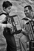 Hans and Gino Taikon, father and son and Swedish Kalderash Roma, play the accordion together
