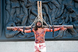 © London News Pictures. 06/04/2012. London, UK.  Jesus on the cross. Actors perform The Passion of Jesus  in front of thousands of people in Trafalgar Square in central London, England on  April 6, 2012  to mark Good Friday. The actors come from the Wintershall Estate in Surrey. Photo credit :  Ben Cawthra/LNP