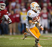 Nov 12, 2011; Fayetteville, AR, USA;  Tennessee Volunteers tailback Devrin Young returns the ball during a game against the Arkansas Razorbacks at Donald W. Reynolds Razorback Stadium. Arkansas defeated Tennessee 49-7. Mandatory Credit: Beth Hall-US PRESSWIRE