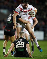St Helens Saints' Alex Walmsley is tackled by London Broncos' Eloi Pelissier and Matthew Davies, during the Betfred Super League match at the Totally Wicked Stadium, St Helens.