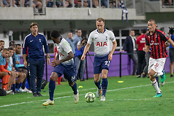 July 31, 2018 - Minneapolis, Minnesota, U.S - Tottenham's CHRISTIAN ERIKSEN (23) carries the ball down the right wing behind GEORGES-KEVIN N'KOUDOU (14) and in front of Milan's LUCA ANTONELLI as Spurs manager MAURICIO POCHETTINO shouts encouragement from the bench. (Credit Image: © Keith R. Crowley via ZUMA Wire)