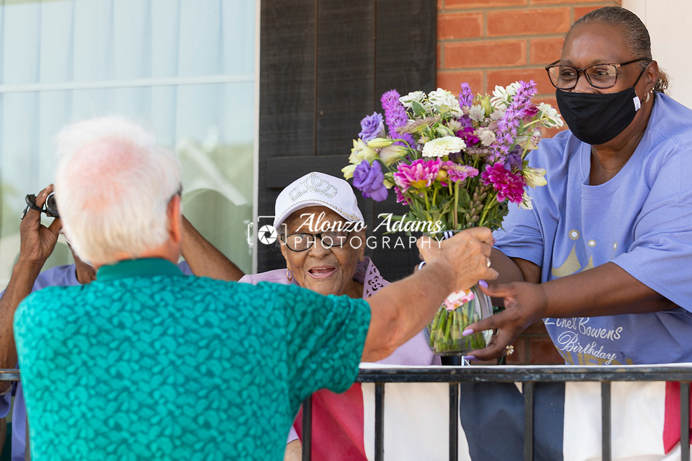 Guthrie Oklahoma Mayor, Steven Gentling, left, presents flowers to Ethel M. Bowens, center, during a parade in celebration of her birthday and being the oldest living Oklahoman on Saturday, Aug. 21, 2021. Photo by Alonzo J. Adams.