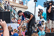 America's Cup Village, Bermuda, 26th June 2017. Emirates Team New Zealand helmsman Peter Burling shakes hands with fans after winning the America's Cup.