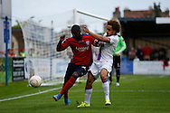 Reise Allassani making a challenge during the Pre-Season Friendly match between Hampton & Richmond and Crystal Palace at Beveree Stadium, Richmond Upon Thames, United Kingdom on 27 July 2015. Photo by Michael Hulf.
