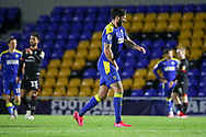 AFC Wimbledon striker Ollie Palmer (9) recovering from getting ball kicked against him during the EFL Sky Bet League 1 match between AFC Wimbledon and Lincoln City at Plough Lane, London, United Kingdom on 2 January 2021.