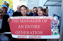 Arsenal fans hold up a sign dedicated to Arsenal manager Arsene Wenger before the match begins