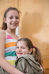 Portrait of sisters, smiling