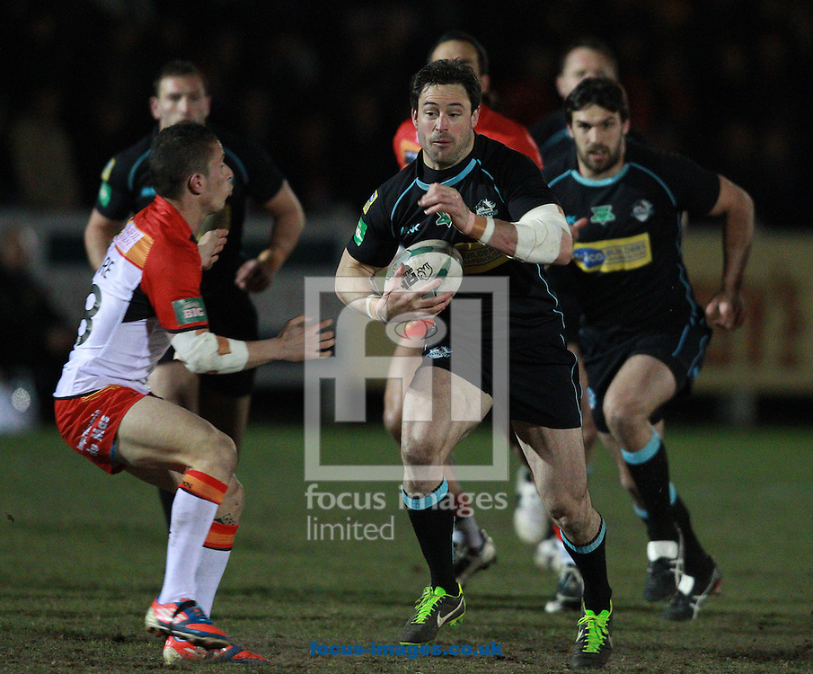 Picture by Paul Terry/Focus Images Ltd +44 7545 642257.28/03/2013.Chris Bailey ( C ) of London Broncos looks to go past Morgan Escare ( L ) of Catalans Dragons during the Super League match at Esher Rugby Union Club , London.