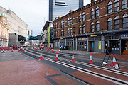 New tramlines on a very empty Broad Street, which is Birminghams main street for entertainment and bars, but with barely anyone walking around during the third national coronavirus lockdown in Birmingham on 18th January 2021 in Birmingham, United Kingdom. Following the recent surge in cases including the new variant of Covid-19, this nationwide lockdown, which is an effective Tier Five, advises all citizens to follow the message to stay at home, protect the NHS and save lives.