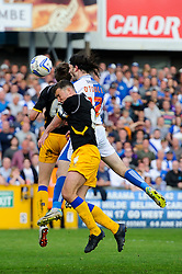 John-Joe O'Toole (IRL) of Bristol Rovers heads a dhot as John Dempster (SCO) of Mansfield Town challenges - Photo mandatory by-line: Rogan Thomson/JMP - 07966 386802 - 03/05/2014 - SPORT - FOOTBALL - Memorial Stadium, Bristol - Bristol Rovers v Mansfield Town - Sky Bet League Two. (Note: Mansfield are wearing a Rovers spare kit having forgotten their own).