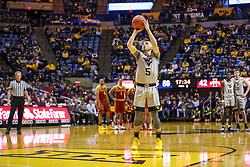 Mar 6, 2019; Morgantown, WV, USA; West Virginia Mountaineers guard Jordan McCabe (5) shoots a foul shot after a technical foul during the second half against the Iowa State Cyclones at WVU Coliseum. Mandatory Credit: Ben Queen-USA TODAY Sports