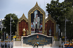 May 2, 2019 - Bangkok, Thailand - Well-wishers seen walking past a portrait of Thailand's King Maha Vajiralongkorn Bodindradebayavarangkun (Rama X) ahead of the royal coronation in Bangkok. (Credit Image: © Chaiwat Subprasom/SOPA Images via ZUMA Wire)