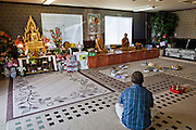 24 OCTOBER 2010 - CHANDLER, AZ: Ajahn RAYWAT and Ajahn MAKA AMPORN in the meditation room before the start of prayers during the Ok Phansa services to mark the end of Buddhist Lent at Wat Pa, in Chandler, AZ, Sunday October 24. Buddhist Lent is a time devoted to study and meditation. Buddhist monks remain within the temple grounds and do not venture out for a period of three months starting from the first day of the waning moon of the eighth lunar month (in July) to the fifteenth day of the waxing moon of the eleventh lunar month (in October). Ok Phansa Day marks the end of the Buddhist lent and falls on the full moon of the eleventh lunar month, this year Oct 23. Wat Pa, a Thai Theravada Buddhist temple, celebrated Ok Phansa Day on October 24.    Photo by Jack Kurtz