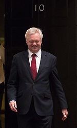 © Licensed to London News Pictures. 16/10/2017. London, UK. Brexit Secretary David Davis smiles as he leaves Downing Street for Brussels. Later Mrs May and Brexit Secretary David Davis will have dinner with EU chief negotiator Michel Barnier and Commission chief Jean-Claude Juncker in Brussels after Brexit talks were described as being in deadlock. Photo credit: Peter Macdiarmid/LNP