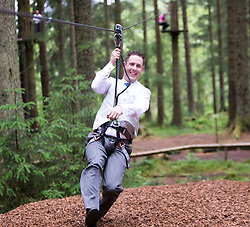 Martin Milner and Colette Gregory tying the knot in the trees at Go Ape Aberfoyle. Martin landing of a zip wire.