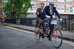 © Licensed to London News Pictures. 04/05/2019. LONDON, UK.  Participants prepare to take part in the annual Tweed Run.  The 12 mile ride takes in landmarks around central London, with stops for tea en route, and all with riders in vintage dress.  Photo credit: Stephen Chung/LNP