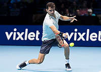 Tennis - 2017 Nitto ATP Finals at The O2 - Day Two<br /> <br /> Group Pete Sampras Singles: Dominic Thiem (Austria) Vs Grigor Dimitrov (Bulgaria)<br /> <br /> Grigor Dimitrov (Bulgaria) stoops to return a low pass at the O2 Arena <br /> <br /> <br /> COLORSPORT/DANIEL BEARHAM