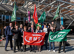 Pictured: Richard Leonard was joined by other MSPs inluding Jackie Baillie, Patrick Harvie, Claudia Beamish, Elaine Smith, Neil Finlay and others.tofly the flag of protest<br /><br />Richard Leonard, leader of Scottish labour, Patrick Harvie, co-leader of the Scotrtish Greens, joined other MSPs and memberes of the RMT union today to protest against Abellio contract. The rail union were demonstrating outside the Scottish Parliament in a call for the termination of privateer Abellio ScotRail's contract.<br /><br />Ger Harley | EEm 2 October 2019