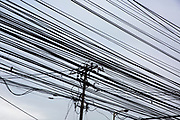 Telephone cables viewed from below running through Manila, Metro Manila, Philippines.  (photo by Andrew Aitchison / In pictures via Getty Images)