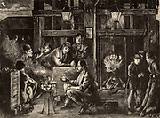 South Durham Coalfield, England.  Miners or pitmen sitting round a brazier waiting to go underground for the night shift.  The man in the centre foregound is holding a Davy safety lamp and smoking a clay pipe.   At centre right men are in the cage ready to be lowered to the bottom of the pit.  On the right, the boys who work the pit ponies chat amongst themselves.   Engraving from 'The Graphic' (London, 4 February 1871).